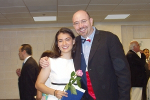 Mike Feinberg congratulates Evita Garza at her graduation.